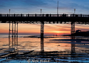 Sunset on the seafront at Worthing Pier, West Sussex. by Nick Blake 